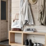 elements minimal mudroom hallway foyer design a floating pine shelf offers a spot for bags shoes and mail bobby houstons cabin decor modern cabin decorating ideas country living