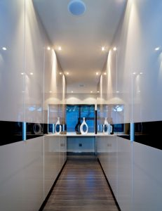 exterior-entrance-hall-with-a-modern-decor-wall-white-mica-wood-flooring-fitted-wall-lights-as-well-as-two-bottles-and-mirrors-beautiful-hallway-design-ideas-a-narrow-hallway-cabinet-inspiration