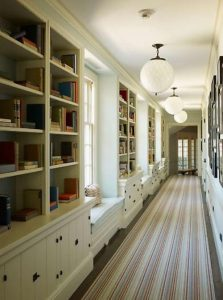 narrow-hall-cabinet-furniture-with-shelves-and-storages-a-long-hallway-interior-with-unique-pendant-lamps-a-beautiully-simple-hallway-design-with-narrow-hallway-cabinet-made-of-wood-design-material
