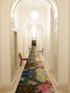 narrow-hallway-colorful-rug