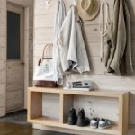simple-solution-a-floating-pine-shelf-offers-a-spot-for-bags-shoes-and-mail-in-the-entrance-hallway-of-this-massachusetts-cabin-steel-hooks-from-the-land-of-nod-corral-coats-scarves-and-more